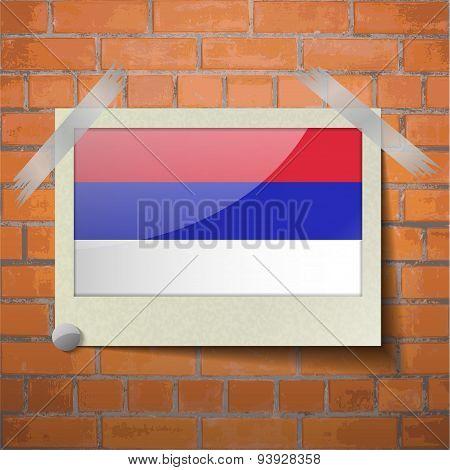 Flags Republika Srpska Scotch Taped To A Red Brick Wall