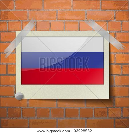 Flags Russia Scotch Taped To A Red Brick Wall