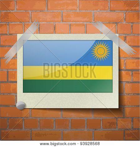 Flags Rwanda Scotch Taped To A Red Brick Wall