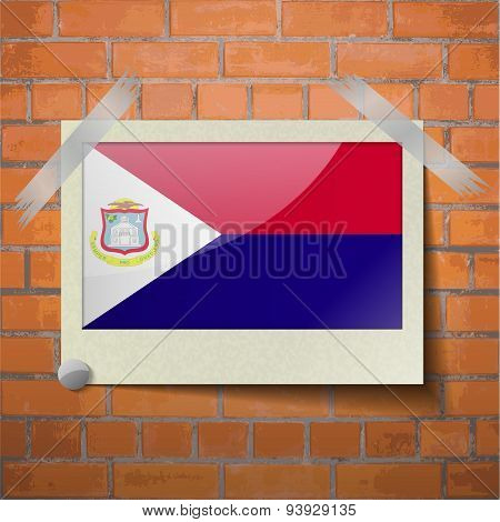 Flags Saint Martin Scotch Taped To A Red Brick Wall