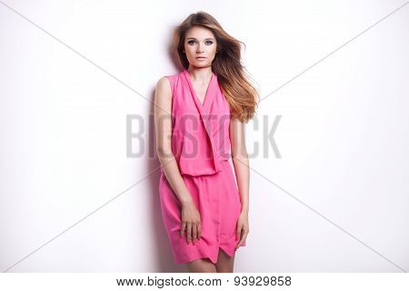 Young Fashionable Girl In Pink Dress.