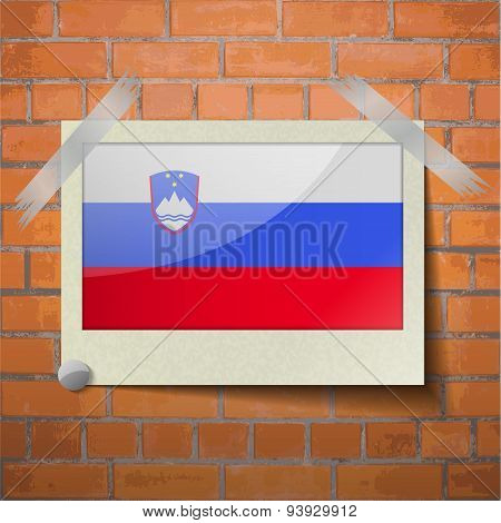 Flags Slovenia Scotch Taped To A Red Brick Wall