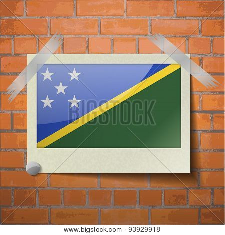 Flags Solomon Islands Scotch Taped To A Red Brick Wall