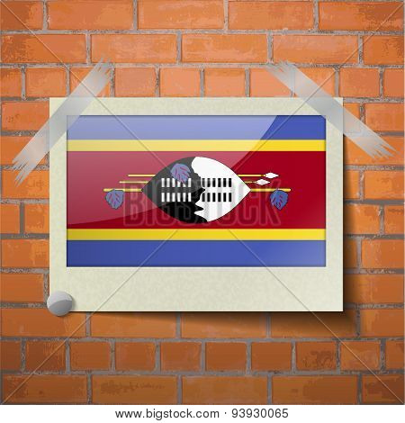 Flags Swaziland Scotch Taped To A Red Brick Wall