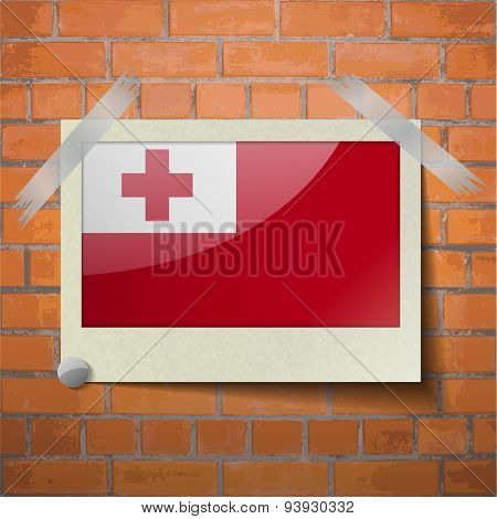 Flags Tonga Scotch Taped To A Red Brick Wall