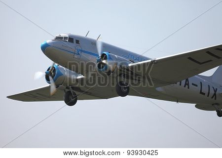 BUDAORS, HUNGARY - APRIL 27: Li-2 aircraft climbing on 27th April, 2014. This aircraft is 65 years old.