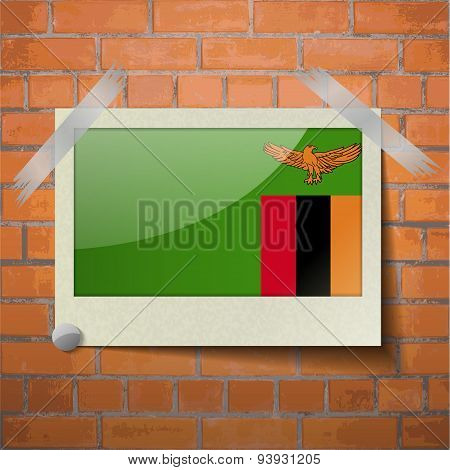 Flags Zambia Scotch Taped To A Red Brick Wall