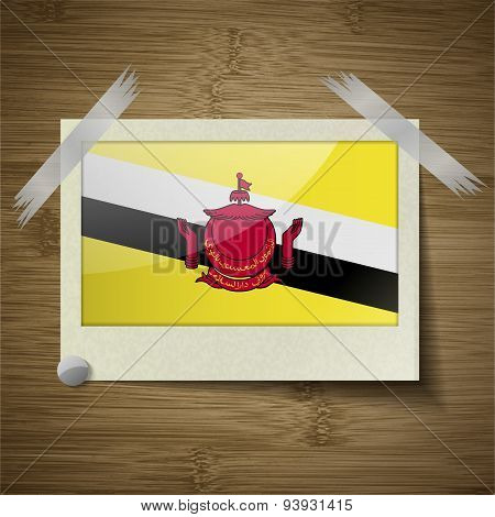 Flags Brunei At Frame On Wooden Texture. Vector