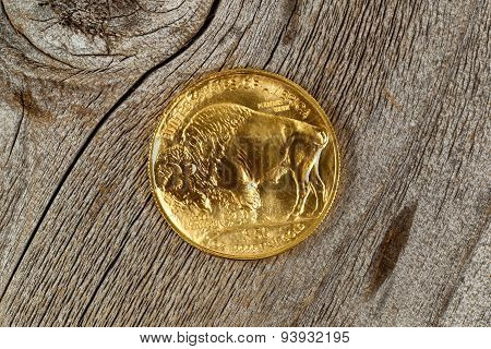 Fine Gold Buffalo Coin On Rustic Wooden Background
