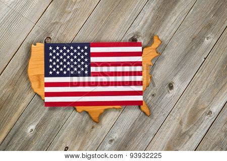 Flag Over Top Of United States Of America Shape On Rustic Wooden Boards