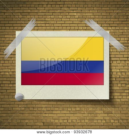 Flags Colombia At Frame On A Brick Background. Vector