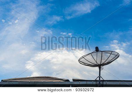A Black Satellite Dish On Blue Sky Background