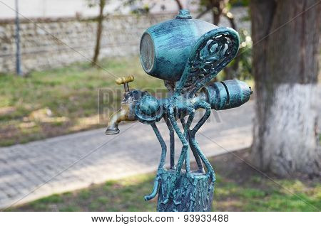 Telavi, GE - Feb, 28 2015:Mosquito-faucet with keg - part of the original bench-sculpture in Telavi