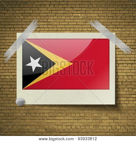 Flags East Timor At Frame On A Brick Background. Vector