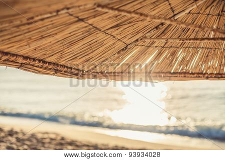 Sunrise On A Beautiful Sandy Beach With Sunshade