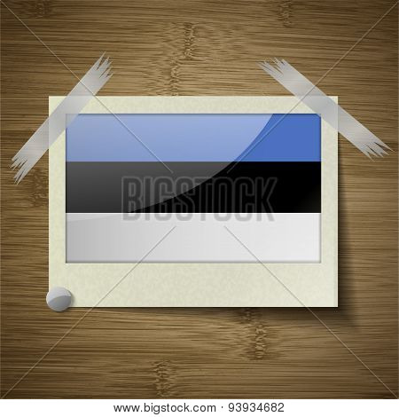 Flags Estonia At Frame On Wooden Texture. Vector