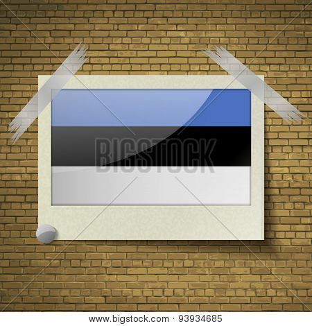 Flags Estonia At Frame On A Brick Background. Vector