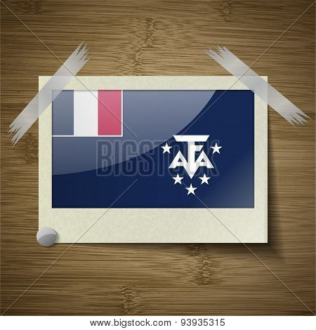 Flags Of French And Antarcic At Frame On Wooden Texture. Vector