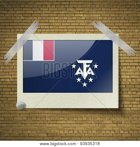 Flags Of French And Antarcic At Frame On A Brick Background. Vector