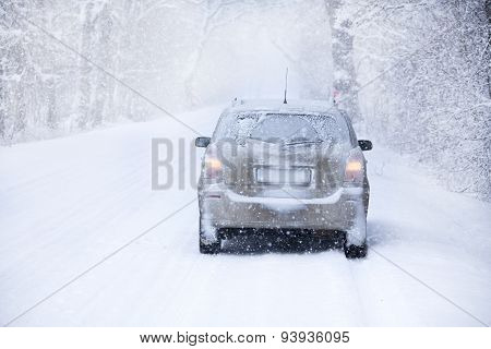 Car On The Winter Road In Snowstorm Time