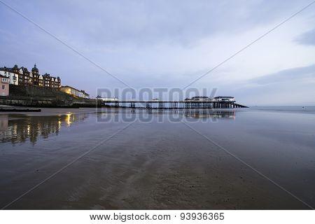 Sunrise Over The Pier Of Cromer