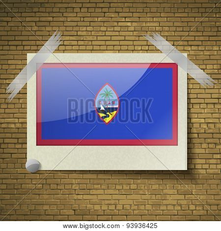Flags Guam At Frame On A Brick Background. Vector
