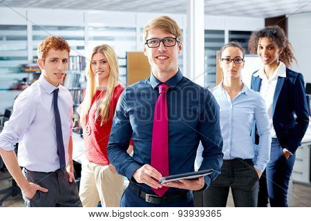 Blond young businessman multi ethnic teamwork group as leader in office