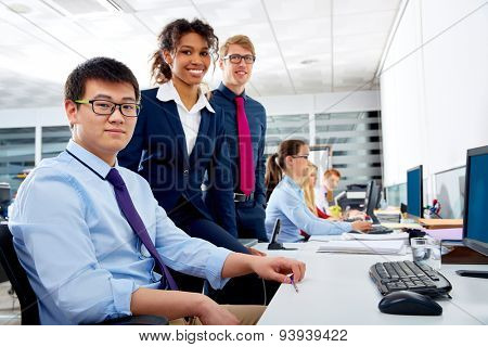 Business team young people multi ethnic teamwork in office computer