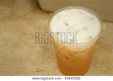 Iced Coffee On A Background Of Cement.