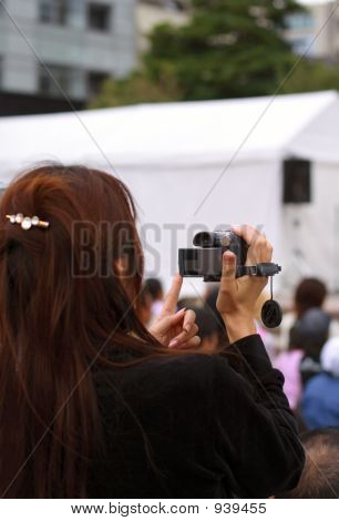 Woman Recording An Event