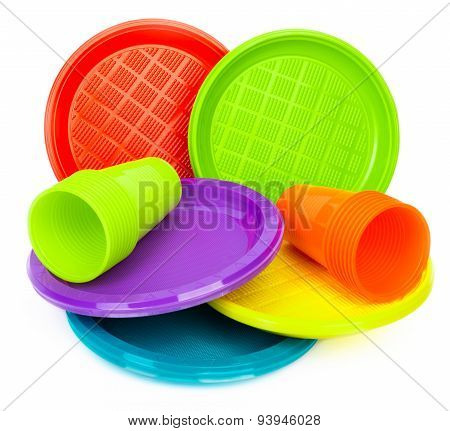 Bright plastic plates with cups