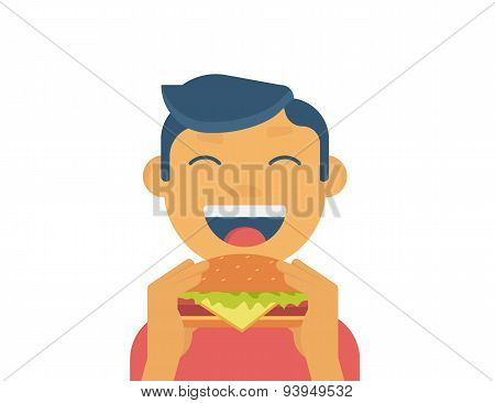 Happy boy eating a big hamburger