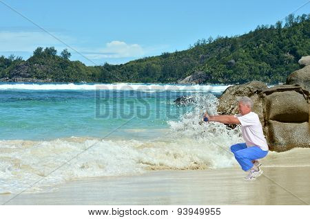 Senior man exercising in summer on  seashore