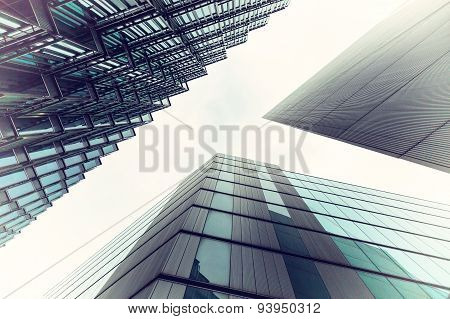 A Vintage Image Looking Up Capturing Three Different Buildings On An Angle