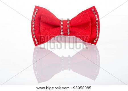 red bow tie with sequins on a white background