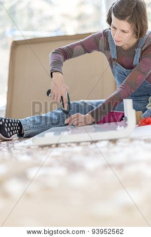 Competent Woman Assembling Flat Pack Furniture