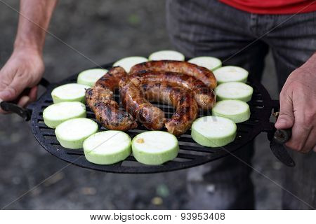 Person Holding Barbecue Grill