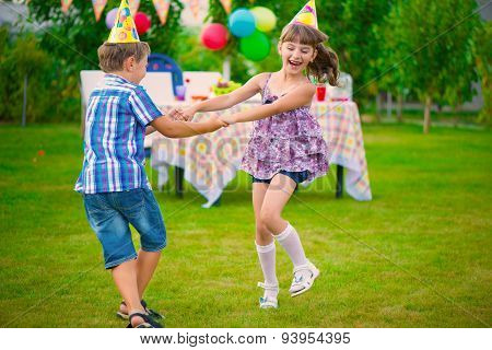 Two Little Kids Dancing Roundelay
