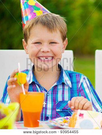 Happy Boy Having Fun At Birthday Party