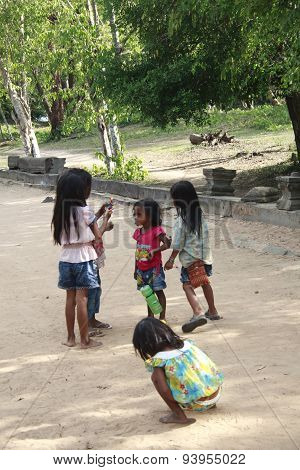 Group Of Young Children Stand By The Road Side