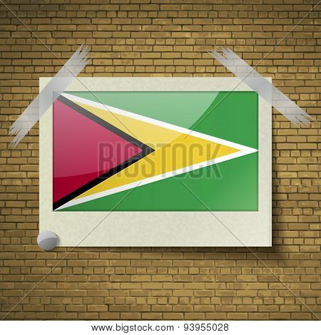 Flags Guyana At Frame On A Brick Background. Vector