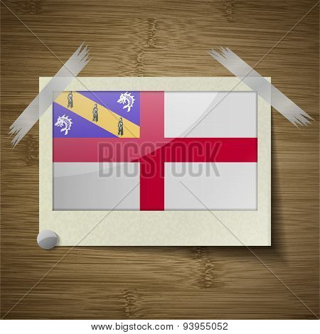 Flags Herm At Frame On Wooden Texture. Vector