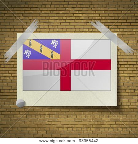 Flags Herm At Frame On A Brick Background. Vector