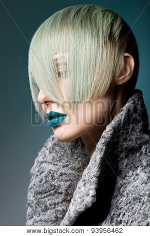 Blonde Beautiful Girl With Blue Coloured Hairstyle And Blue Lips