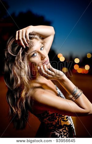 Portrait of a young beautiful girl posing outdoor in the night