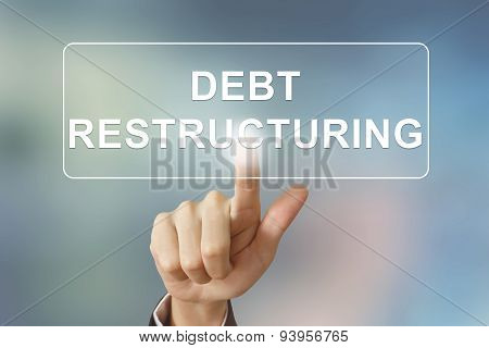 Business Hand Clicking Debt Restructuring Button On Blurred Background