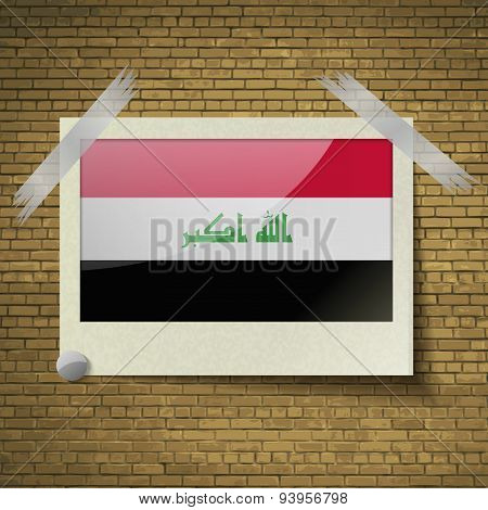 Flags Iraq At Frame On A Brick Background. Vector