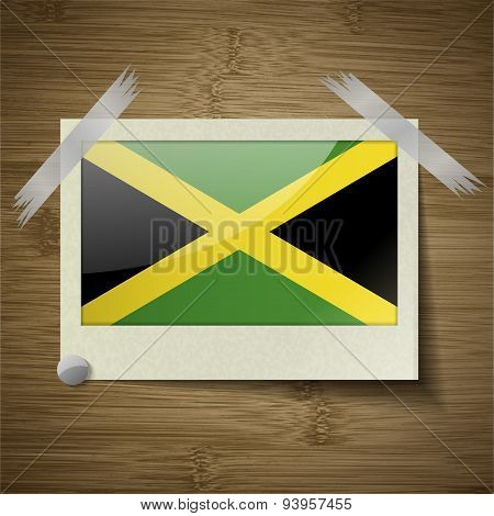 Flags Jamaica At Frame On Wooden Texture. Vector