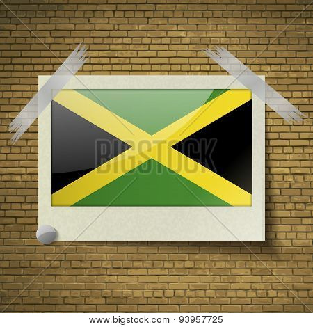 Flags Jamaica At Frame On A Brick Background. Vector