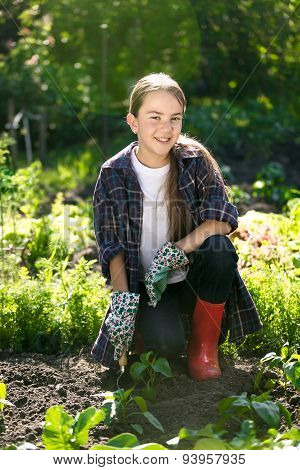 Smiling Girl Working At Garden At Hot Sunny Day